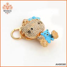 Wholesale cute gold Kitty with enamel bear rhinestone keychain