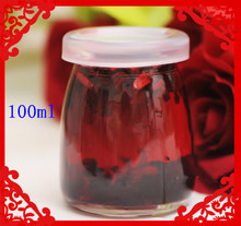 Botella de vidrio de budín de mini 100 ml con tapa de plástico al por mayor