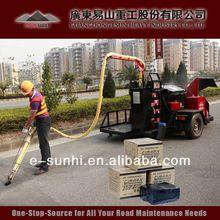 TE-I hot pour pavement sealer