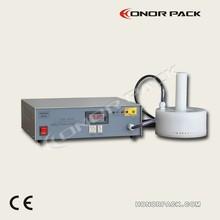 hand held induction cap sealer
