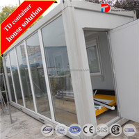 Flat packed glass container cottages / house