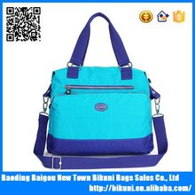 Custom logo blue water resistant handbags for girl daily leisure handbag with strap
