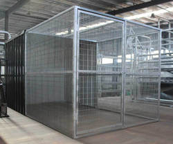 Large iron fence dog kennel