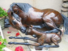 Metal life size brass mare and foal sculpture for sale