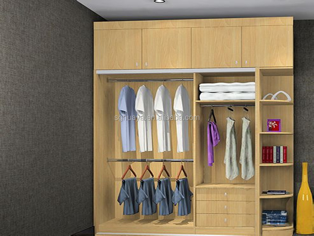 Modern bedroom sliding door wardrobe design indian bedroom for Bedroom wooden wardrobe designs india