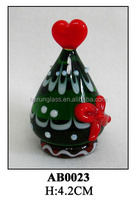 decorative glass bottle with glass bowknow and red heart