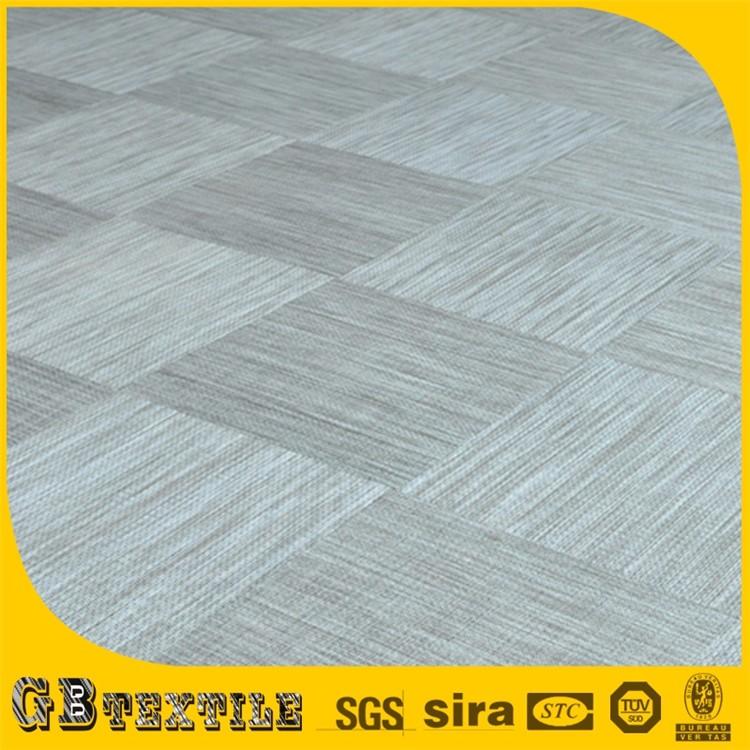 Woven vinyl floor tiles