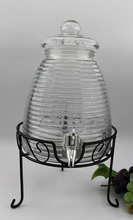 glass wine dispenser with glass lid and iron stand