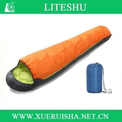 compressed compact duck down sleeping bag in mummy style
