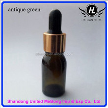 Wholesale 10ml antique green glass essential oil bottle with golden dropper