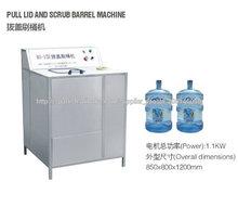 lavadora y destapadora de bidones que trabaja manual