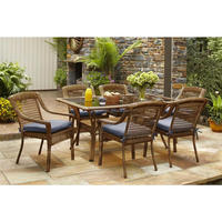 American style round wicker frozen glass top outdoor table with umbrella hole and stackable rattan chair