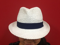 white woven paper straw hat with woven band