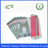 Purplish red poly mailiers/PE express delivery mailing bags.
