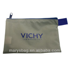 Gray 200 D nylon cosmetic case with a royal blue top zipper closure and webbing tab