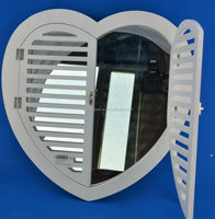 heart shaped wall mirror with wooden frame and white grid for home decoration