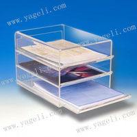 Three sliding A4 file drawers housed in a clear acrylic desktop unit