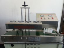 continuous electromagnetic induction sealer for jars/bottle