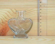 Heart shape small candy bottle clear glass bottle with easy open cap large quantity in stock