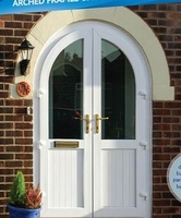 Arched frame-top door