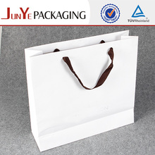 2014 direct factory best quality fashionable paw print paper shopping paper shopping for packaging rice kraft paper bag