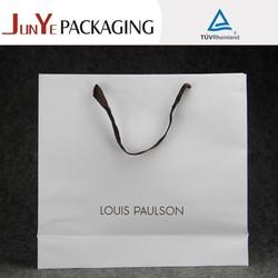 Soft plain handles elegant designed die cut garment white kraft paper bag