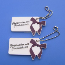 custom white soft rubber pvc keychain | keyring | key trinket with bowknot decoration