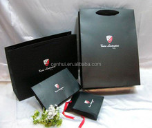 new design wholesale cheap paper shopping bags with your own logo
