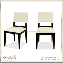 white fabric seat and back black frame ding chair