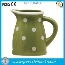 White polka dots on moss green ceramic Pitcher Earthware