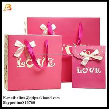 Custom special design pink wedding paper gift bags, door gift paper bag with ribbon handle