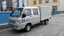Electric cargo container vehicle