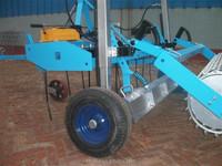 Rake and roll arena harrow with hydraulic