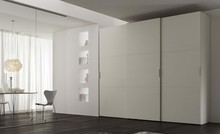 White rubber wall to wall sliding wardrobe doors