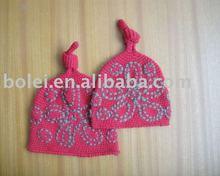 Children knitted hat with flower design