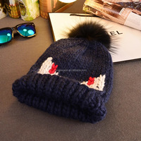 design thick knit fur pom pom beanie