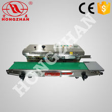Hongzhan CBS-900/980/1100 plastic film aluminum foil sealing Vertical continuous band bag sealer machine