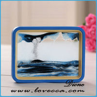 blue flowing sand pictures, black frame flowing sand pictures