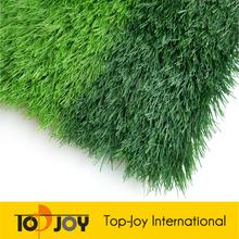 Verde de la hierba artificial de fútbol