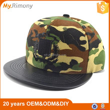 China wholesale custom camo embroidery snapback cap with faux leather visor