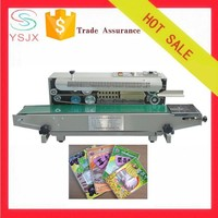 Continuous electric plastic bag snack sealing machine
