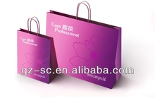 Exclusive custom shopping paper bags with handle in CMYK/PMS