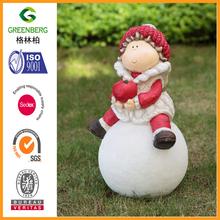 Christmas girl gnome statue holding apple on ball for garden decoration