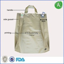 Good quality plastic shopping bags with punch handle for books,clothing,shoes