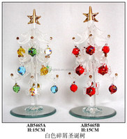 white clear glass christmas tree hanging red fish on the branch