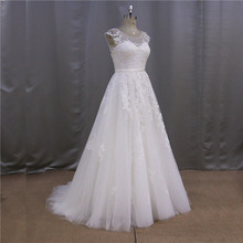 2015 pictures of latest sleeveless pearls beaded bust 2012 bling wedding dress