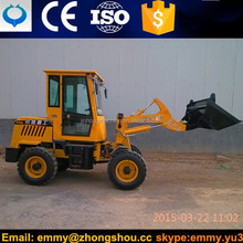 Family used snow remove loader with snow blade attachment