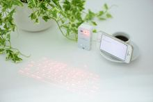 With led red light tablet with laser keyboard