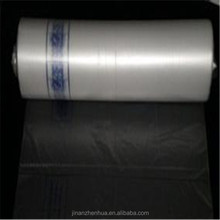 Plastic transparent flat bags on roll with paper core for vegetables and fruits