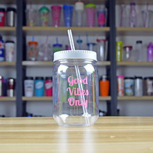 Clear plastic mason jar cup with a straw